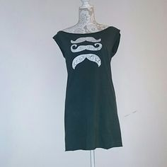 Mustache tunic dress Bought off Etsy, homemade with a square cut. Mustache print has faded in a wash but I like the aesthetic. No tag, fits me as a small (I always wore with a belt) but can fit a medium due to the cut. Not hemmed so the edges roll up, but it never bothered me. Dark green in color, hard to show in pictures.   Measures 17in flat, no tapering in the cut. 28in length Dresses