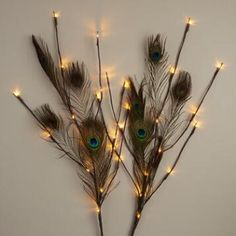Our rustic branches are adorned with peacock feathers and 30 warm white LED lights that fill the room with color and shine. Vibrant decorations for the harvest season and beyond, they look great placed in a pot or vase. Diwali Decoration Lights, Thali Decoration Ideas, Diwali Decorations At Home, Home Wedding Decorations, Festival Decorations, Flower Decorations, Stage Decorations, Peacock Room Decor, Peacock Bedroom