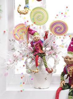 Floral arrangement using Candy Wonderland Elf, large lollipops, candy and gumdrop sprays.