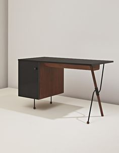 GRETA MAGNUSSON-GROSSMAN, Desk, model no. 6200, ca. 1952. Plastic-laminated wood, walnut-veneered wood, painted tubular metal and painted metal. Manufactured by Glenn of California, USA.