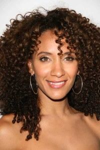 Dark brunette with spiral curls and a side part hairstyle