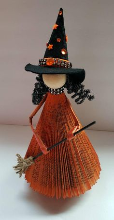 This beautiful witch is made from a previously loved book. Adorned with a handmade broom. Finished with black paint and rhinestones. The base is a reel of ribbon reworked to add srigndiness. Some customization is available. Contact me as soon as you Retro Halloween, Halloween Arts And Crafts, Easy Christmas Crafts, Diy Halloween Decorations, Easy Halloween, Fall Crafts, Old Book Crafts, Book Page Crafts, Newspaper Crafts