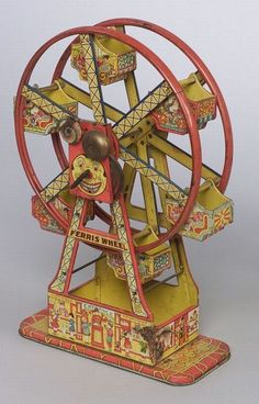 "Chein & Co. ""Hercules"" Ferris Wheel, lithographed tin in red and yellow with smiling moon face at the axis, bell, six lithographed chairboats."
