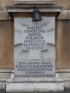 "A ""Tchorek plaque"" on Kredytowa Street in Warsaw, which commemorates 15 Polish resistance fighters who were killed here while fighting against the Germans in August 1944, during the Warsaw Uprising...."