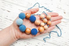 Items similar to Nursing necklace - Teething necklace - Baby nursing toy - Necklace for mom - Juniper Wood - Organic cotton - Blue on Etsy Nursing Necklace, Teething Necklace, Crochet Necklace, Beaded Necklace, Beaded Bracelets, Toy, Trending Outfits, Unique Jewelry, Classic