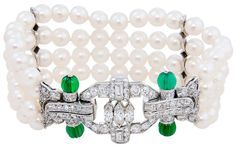 Art Deco Pearl and Diamond Bracelet     Circa 1930s.    Art Deco Platinum, Pearl, Diamond and Carved Chrysophrase Bracelet. Set with Round, baguette and Marquis Diamonds totaling 2.25 carat. 4 rows of 5.8 M.M. Pearls. Via 1stdibs.