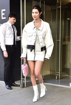 Bella Hadid showed us that all white is all right in this monochrome ensemble. For a pop of fun color, she carried a furry pink purse.