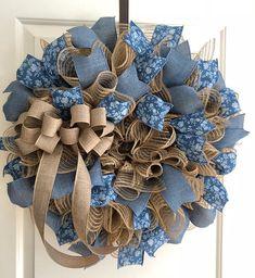 Burlap Deco Mesh with blue floral and denim wreath. Perfect for the rustic country decor. Approx. 22 inches in diameter.