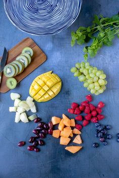 Ingredients laid out for the ultimate fruit platter recipe - kiwi, melons, grapes, berries, mint and Mexican Fruit Salads, Eat Fruit, Fruit Art, Fruit Dips, Fresh Figs, Fresh Fruit, Fruit Cake Watermelon, Fruit Cakes, Vegetable Stand