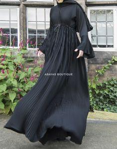 Pleats Please - our pleated fabric lends a wonderful sense of fluidity to this pleasingly rich black abaya. Modest Fashion Hijab, Abaya Fashion, Muslim Fashion, Fashion Dresses, Abaya Designs Latest, Arabic Dress, Black Abaya, Pleated Fabric, Abaya Style