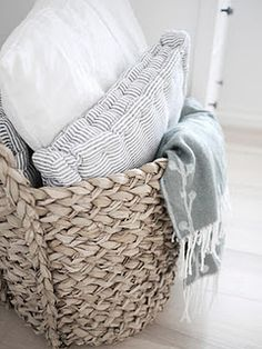 Seagrass basket with linens and pillows