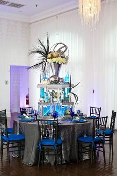 Beautiful blue wedding table and centerpiece!