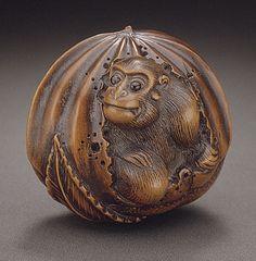 Naito Toyomasa (Japan, 1773 - 1856)  Monkey in Chestnut, first half of 19th century  Netsuke, Wood with inlays