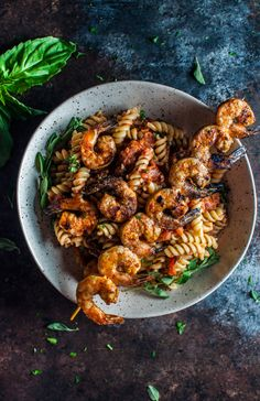 This spicy pasta with grilled shrimp is a marriage made in food heaven. The shrimp are to die for!