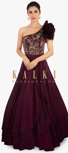 One shoulder satin crepe plum gown .Enhanced with 3 D flower highlighting the shoulder. Has bodice intricate in sequin and zardosi floral embroidery Indian Wedding Gowns, Indian Gowns, Anarkali, Lehenga, Sabyasachi, Designer Gowns, Indian Designer Wear, 50s Dresses, Bridal Dresses
