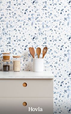 Dive into the cool depths of modern wall design with our stylish Spritz pattern. This terrazzo-themed wallpaper is packed full of home trends that are ready to bring your space up to date. Each of the terrazzo shapes has a painted marble design within, which adds texture and an artistic style to the pattern. The background color is white, and the flecks are all decorated in a variety of soft blue tones that feel fresh and relaxing. Kitchen Wallpaper Murals, World Map Wallpaper, Forest Wallpaper, Terrazo, Space Up, Design Repeats, Home Trends, Blue Tones, Repeating Patterns