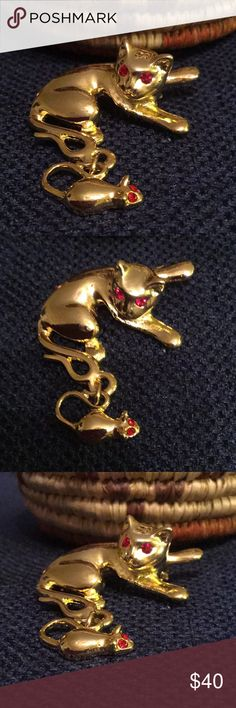Vintage Gold-tone Cat & Mouse Brooch/Pin Vintage brooch/Pin Gold-Tone Cat And Mouse with red crystal eyes.. 1 1/2 Inches by 1 1/2 Inches. Excellent condition. Jewelry Brooches