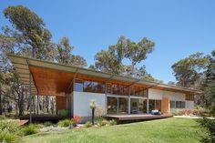 Archterra Architects designed the Bush House, a solar-powered abode that blends environmental sustainability with contemporary luxury.
