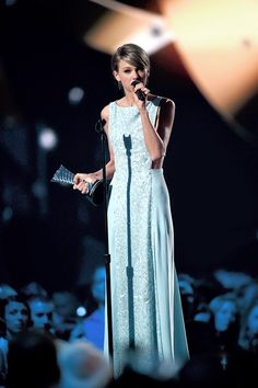 Taylor Swift accepting the 50th anniversary milestone award at the ACMs 2015