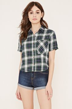 In woven cotton, this tartan plaid shirt features a boxy shape, a basic collar, cuffed short sleeves, a chest patch pocket, and a button-up front.