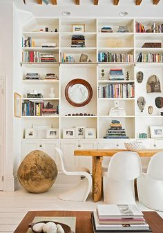 Furniture // floor-to-ceiling display cabinets, thick wooden table, and plastic chairs. Yes please!