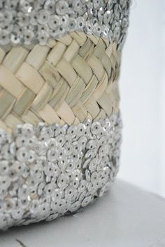love the contrast between silver sequins and natural wicker work <3