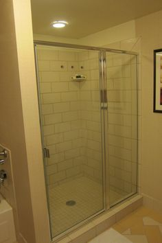shower stall with tiled walls