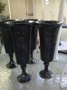 Vases....wedding. a candle stick on bottom glued with plastic vase on top. Prayed with black to match .....