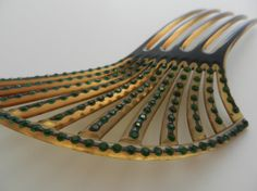 Black-on-clear celluloid asymmetrical Art Deco hair comb with green paste stones