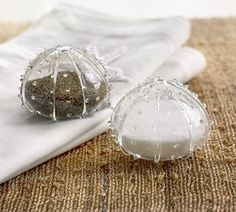 5 Salt and pepper shakers Help your summer hostess shake up a waterside picnic with these adorable glass sea urchin salt and pepper shakers.  US, Pottery Barn.