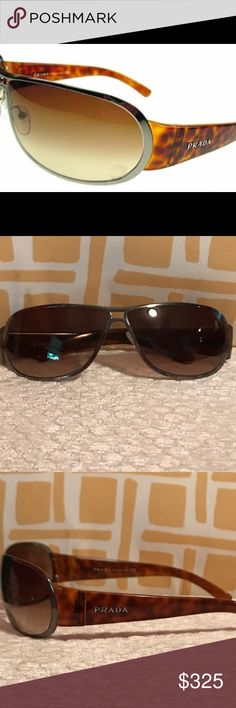 Discontinued Prada SPR 70G - Sunglasses Model: SPR 70G Prada Color:  5AV-2Z1(Tortoise Graphite/Soft Brown Lenses) Size: 69  Bridge: 09  Temples: 125  Product Year: 2006  Some surface scratches consistent with normal light use.  Left nose guard plastic piece is missing but can be replaced.   This product is discontinued by the manufacturer and is unavailable. Prada Accessories Sunglasses