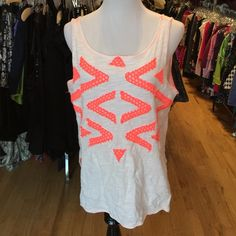 Free People S tank design front Free People S tank design front in gently used clean condition. Minor washwear looks great. No trades no PayPal. Consigned to my boutique. Free People Tops Tank Tops