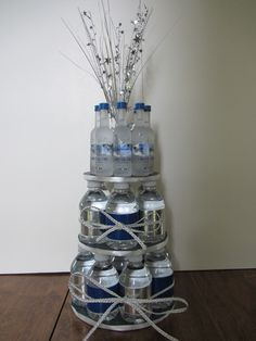 "Great gift for guys in your life... who like to drink. Take their favorite drink(s)/mix and creatively stack them up;   i.e: Grey Goose and Water  ""LIQUID CAKE"""
