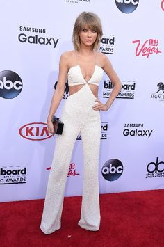 "It's Taylor's big night! After weeks of teasing her star studded video for ""Bad Blood,"" she's finally screened the whole thing. The singer went for a sexier than usual look on the red carpet, in a white cut-out jumpsuit by Olivier Rousteing for Balmain."