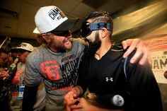 KANSAS CITY, MO - OCTOBER 29: Hunter Pence #8 and Sergio Romo #54 of the San Francisco Giants celebrate in the locker room following a 3-2 victory over the Kansas City Royals in Game Seven of the 2014 World Series at Kauffman Stadium on October 29, 2014 in Kansas City, Missouri. (Photo by Jamie Squire/Getty Images)