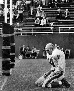 """The image was made at Pitt Stadium on a Sunday afternoon in autumn of 1964. New York Giants quarterback Y.A. Tittle had just been the recipient of a ferocious hit by Steelers defensive end John Baker. Tittle was 38 years old — ancient, by football standards. He was one of the NFL's best quarterbacks. But the moment this picture was made, Tittle's career was nearing a painful conclusion. """"That was the end of my dream,"""" he'd later say."""