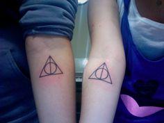 Matching Deathly Hallows symbol tattoos.