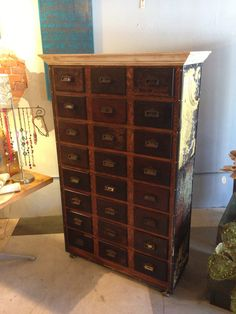 vintage apothecary drawer with an industrial twist by rogue decor co.  vintage tin ceiling used on the sides.  vintage crown moulding wraps the metal riveted top. www.facebook.com/rogue.decor