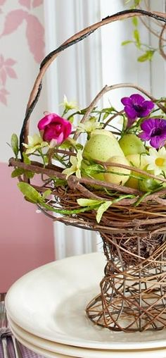 Use a natural grapevine basket for your easter table centerpiece & fill with spring flowers.