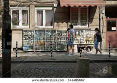 SOFIA, BULGARIA - APRIL 30: People buying groceries in small street shop through the window in Sofia, Bulgaria, on April 30, 2013.