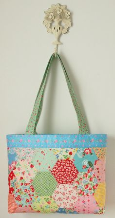 Pretty by Hand - Pretty By Hand. I made that using a charm pack in spring fabrics and Christmas fabrics,