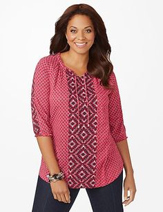 Rich with pattern, our peasant top is great for adding interest to your outfit. The allover circular print is complemented by a medallion center panel that features a keyhole design at the neckline. Ruched elastic ends at the three-quarter sleeves creates a custom fit. Scoop neckline. Catherines tops are designed for the plus size woman to guarantee a flattering fit. catherines.com