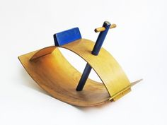 Painted shaped wooden Rocker toy, United States, 1950, by Creative Playthings.