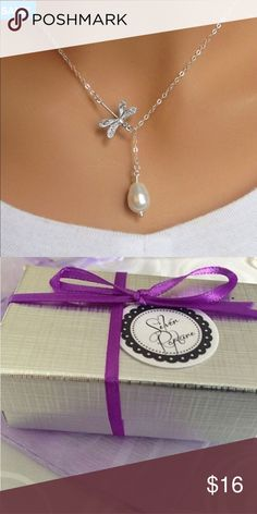 Silver dragonfly necklace Swarovski pearl lariat This is a beautiful silver dragonfly lariat pearl necklace. Comes custom sized from 16 – 22 inches in length.  The necklace comes in a silvery gift box ready to give! Makes a wonderful gift for mom, yourself or even for bridesmaids!  The chain is sterling silver plated with a Swarovski teardrop pearl on the lariat. A sterling silver plated dragonfly charm is attached to the chain so that it does not slide as a traditional lariat. Jewelry…