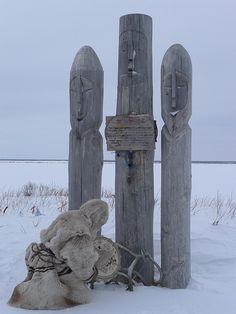 Nenet Kam(Shaman) praying by their totems