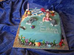 swimming with dolphins cake beach holiday seaweed shells photo picture