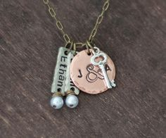 Hand Stamped Mommy Necklace - TWO or THREE Names - Sterling Silver and Mixed Metal Necklace. $39.00, via Etsy.