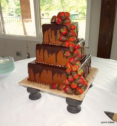 Chocolate Ganache Grooms Cake - Chocolate fudge cake iced in chocolate buttercream with a chocolate ganache drizzle and a cascade of chocolate dipped strawberries.