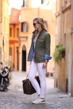 J. Crew olive green utility jacket, denim shirt  worn open over striped tee with field jacket, Adriano Goldschmied white legging ankle jean, gold and white New Balance for J. Crew sneakers, Italian fashion blogger Roma Italy