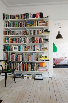 Make bookshelves the focal point of each room